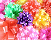 Close-up ribbon gift bow. (red, pink, violet, yellow, green Stock Photos