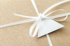 Close up of ribbon and label of envelope. Stock Photography