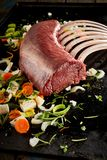 A close up of ribs and herbs grilling on hot plate royalty free stock photos