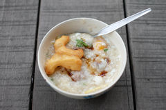 Close-up rice gruel and deep-fried doughstick Royalty Free Stock Photography