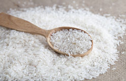 Close up of rice in a wooden spoon Stock Photography