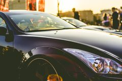 Close up rich retro car on a sunset a vintage style royalty free stock image