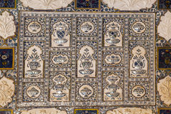 Close-up of a richly decorated wall in Amber fort in Jaipur Royalty Free Stock Photos