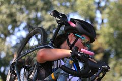 Close-up of Rider carrying bicycle at Cyclocross Cycling Race. September 10, 2017 - Cyclocross extreme cycling on the challenging race terrain Stock Photos