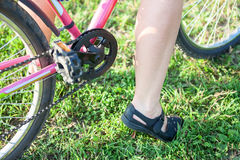 Close-up of rider feet and bicycle pedals unit Royalty Free Stock Photo