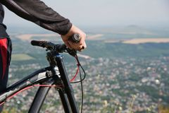 Close-up of a rider`s hand on a mountain bike handlebars royalty free stock images