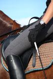 Close up of rider in saddle Stock Photos