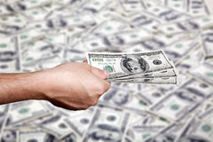 Handing Money over Cash Background Royalty Free Stock Photography