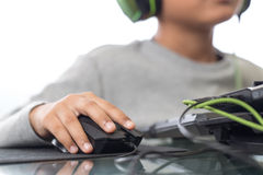 Close up on right hand for clicking over mouse by gamer kid (Sel Stock Images