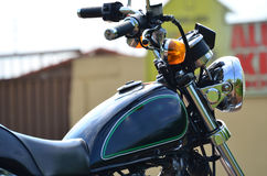 Close up of the Right Side of a Black Custom Motorcycle. Close up Right Side of a Black Custom Motorcycle on the outside Stock Photos