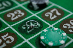 Close-up of ring and chips Stock Photos