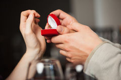 Close up on the ring during marriage proposal Royalty Free Stock Image
