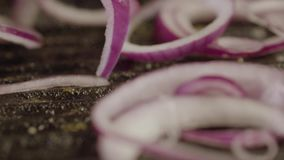 Red Salad Onions Falling On A Red-hot Grill. Close up - Rings Of Red Salad Onions Falling On A Red-hot Grill. Chef Cooks Delicacy stock footage