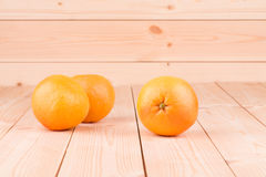 Close up of ripe oranges on wood table. Royalty Free Stock Image