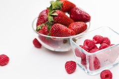 Close up of ripe red strawberries and raspberries Stock Photos