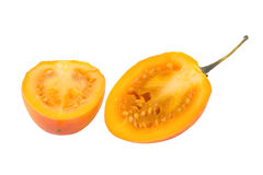 Close-up of a ripe tamarillo cut in half Stock Photos