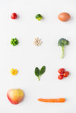 Close up of ripe vegetables and food over white Royalty Free Stock Image