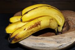 Close-up of ripe yellow bananas in a wooden bowl. Torfhaus, Germany royalty free stock photos