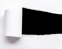 Close up ripped white paper isolated on black Stock Photo