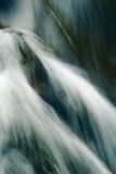 Close-up of river rapids. Close-up long exposure of river rapids, water cascading over rocks - abstract Royalty Free Stock Photos