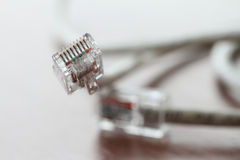 close up of RJ45 Plug Lan Network on wood desk Stock Photography