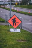 Close up of a road work warning road sign Stock Photo