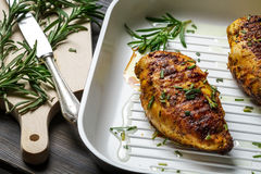 Close-up of roast chicken with rosemary Royalty Free Stock Photo