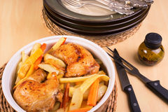 Close up of roasted chicken legs and vegetables in a casserole Royalty Free Stock Photo