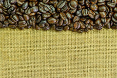 Close up of roasted coffee bean on sack Stock Photography