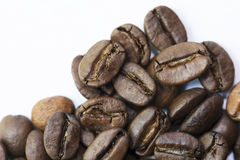 Close up Roasted Coffee Bean. Close-up roasted whole coffee bean on white background Stock Photo
