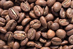 Close-up of roasted coffee beans background. Roasted coffee beans background. Close up royalty free stock photography