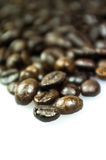 Close Up of Roasted Coffee Beans Isolated on White Background Stock Photos