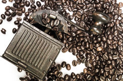 Close Up of Roasted Coffee Beans Isolated on White Background an. D an old coffee grinder Royalty Free Stock Image