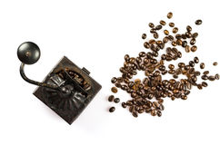 Close Up of Roasted Coffee Beans Isolated on White Background an. D an old coffee grinder Royalty Free Stock Photos