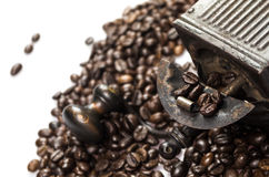 Close Up of Roasted Coffee Beans Isolated on White Background. And an old coffee grinder Royalty Free Stock Photo