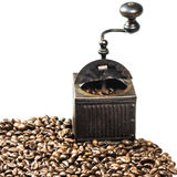Close Up of Roasted Coffee Beans Isolated on White Background. And an old coffee grinder Stock Photos
