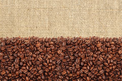 Close-up of roasted coffee beans over linen texture Royalty Free Stock Images