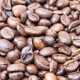 Close up of roasted coffee beans with white background with space for text. to be used as background or texture Stock Photo