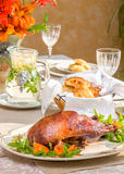 Close up roasted duck on Exquisitely decorated summer time dinner table setting. Stock Images