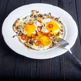 Close up of roasted eggs with onion and chilli Stock Photos