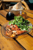 Close up of roasted king prawns with mixed salad Royalty Free Stock Images