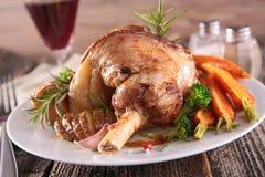 Roasted lamb leg. Close up on roasted lamb leg stock images