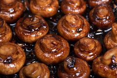 Garlic roasted mushrooms. Close up of roasted mushrooms with garlic and balsamico stock photography