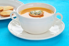 Close-up of roasted-pumpkin soup in a white bowl. Soup made of roasted-pumpkin, parsnip, potatoes, stock and wine in a white bowl Royalty Free Stock Images