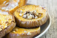 Close-up of roasted pumpkin and seeds royalty free stock images