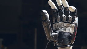 Close up of the robot hand`s closing.