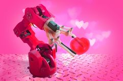Close-up Of A Robot`s Hand Holding Red Heart stock image