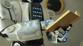 Close up of robotic machine reading book stock footage