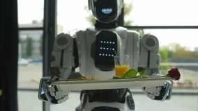 Close up of robotic machine walking with breakfast on tray stock footage