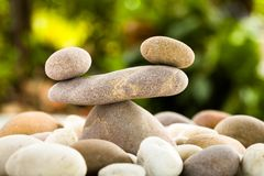 Zen stacked stones on nature background